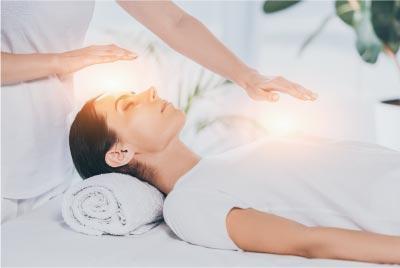 clairvoyant healer practicing reiki